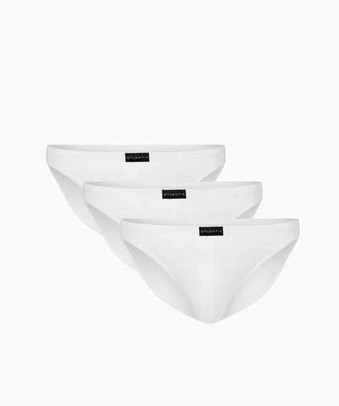Slipy męskie w kolorze białym mini są bardzo wysoko podkrojone wokół ud i mają niską talię wykończoną ledwie wyczuwalną gumą tunelową #1